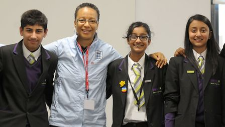 Hope Powell, England's Women Football Coach, visits the Isaac Newton Academy in Ilford.