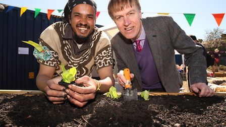 East Ham MP Stephen Timms, right, gets in the spirit of gardening with Bonny Community Association