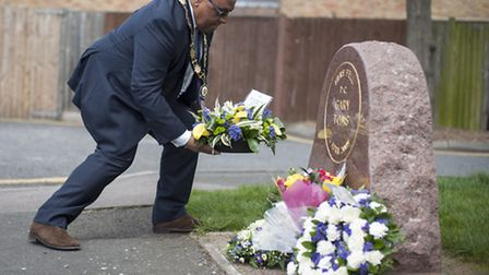 Deputy Mayor Cllr Lester Hudson lays a wreath on the memorial stone of Pc Gary Toms.
