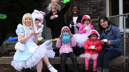 Newham Cllr Charlene McLean joins the Mad Hatter at the Tea Party in the Play Grow Sow Community Cen