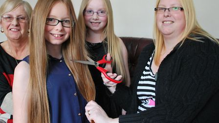 The Chuter girls prepare to lose their locks with their nan Brenda Marsh (left) and mum Julie (right