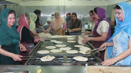 Worshippers prepare food at the gurdwara in Seven Kings ahead of the Vaisakhi festival