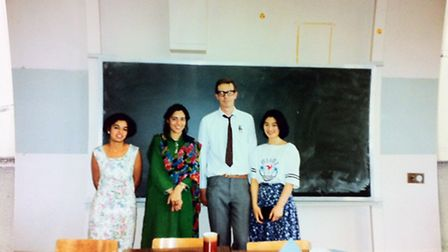 Former math teacher Charlie Carter with students in a picture from 1998.