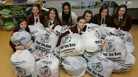 Sharlima Islam and her students with the bags