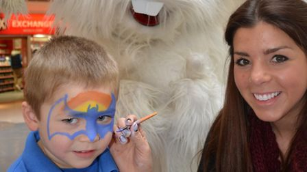 Julie DeCourcey Rolls with the Easter Bunny at the Mercury Mall's Easter Garden