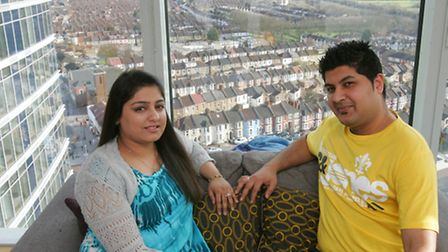 Hamid Khimani and his wife Saimi in their apartment with stunning views over Ilford