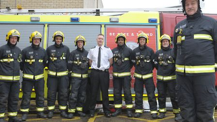 Pat Hegarty (right) with crew members at Ilford fire station
