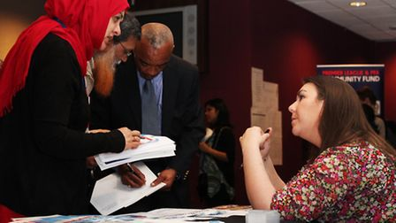 Unemployed people seek for a piece of advice at the Jobs Fair in the Boleyn Ground.
