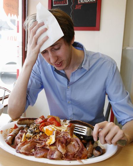 James Schofield during his Man v Food style big breakfast challenge at Cafe on the Heath. Picture Sa