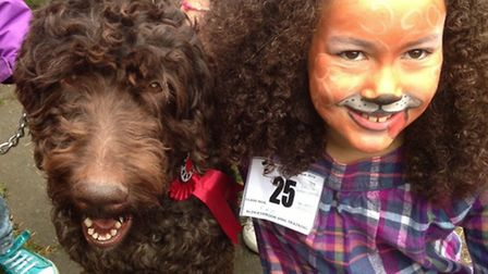 """Phoebe Bull with her pet Labradoodle - the pair won the """"best lookalike"""" category."""