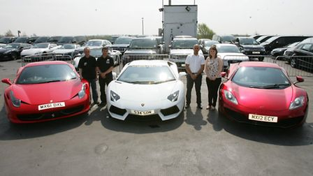 Season Car Hire staff with some of the cars they have for hire