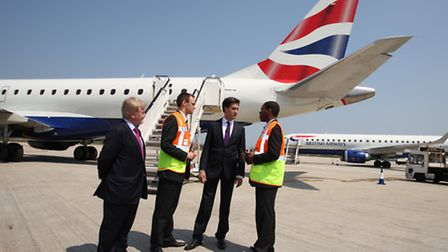 Labour leader Ed Milliband in conversation with London City Airport CEO Declan Collier,left, and air