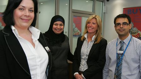 H&T Pawnbrokers manager Addy Archodakis inside the shop with staff Nosheen Ahmad, Jan Harrison and S