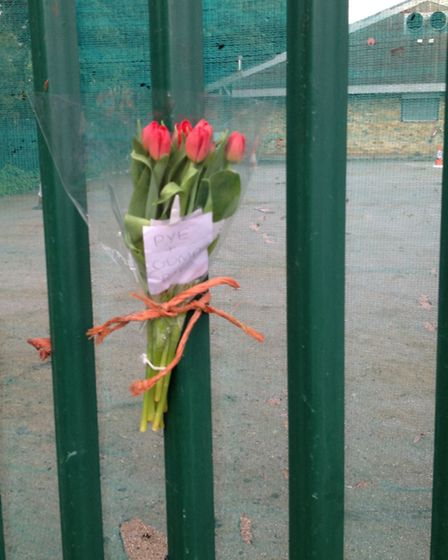 Flowers left in memory of the dead horses at the scene