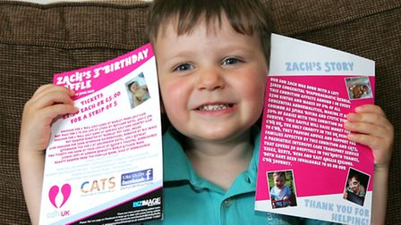 Zach with flyers for his fundraising birthday party