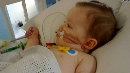 Zach aged eight months in hospital after surgery to repair the hernia that had reopened