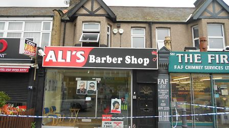 Police have cordoned off an area around Ali's Barber Shop and the flat above in High Road, Ilford