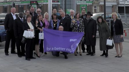 Councillors, residents and business owners recieve the Purple Flag.