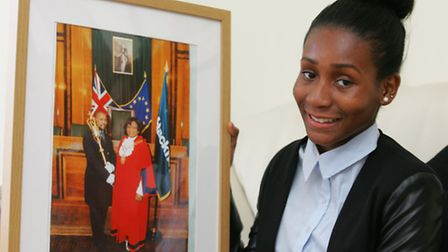 Princess Bright with a picture of her mum and ex mayor of Hackney Sade Bright