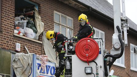 Firefighters face a wall of rubbish (photo: Ellie Hoskins)