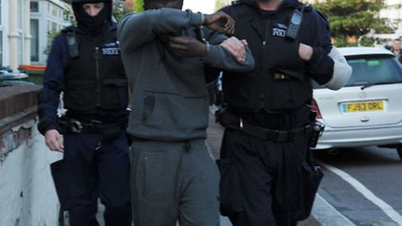 A gang suspect being taken away in Caistor Park Road, Stratford. Picture: David Mirzoeff