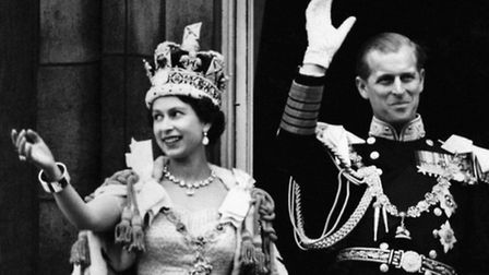 Queen Elizabeth II and the Duke of Edinburgh waving from the balcony after the Coronation
