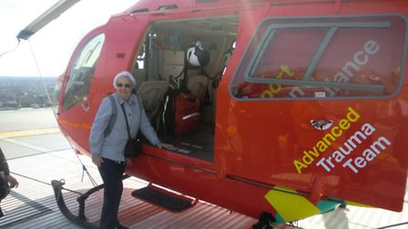 Gladys returns to the helicopter in happier circumstances than her first visit