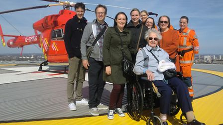 Gladys with her family and Air Ambulance staff at the helipad