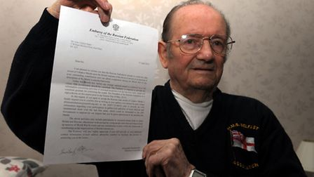 John Seares, 90 with the letter he received from Russian government.