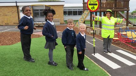 Lollipop lady Hannah Reading teaches children at Broadford Primary School how to cross the road safe