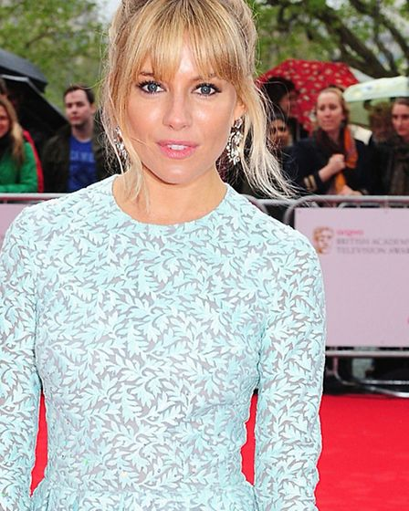 GETTHELOOK 12/05/2013 PA File Photo of Sienna Miller, in a Matthew Williamson dress, arriving for th