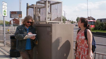 Matt Goddin and Mira Vogel of Barkingside 21 at the defunct air quality station at Fullwell Cross ro