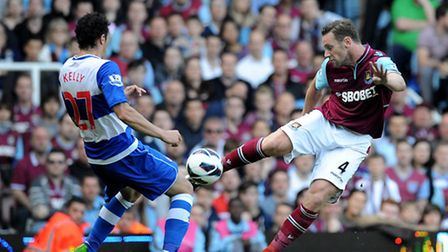 West Ham United's Kevin Nolan (right) passes the ball past Reading's Stephen Kelly during the Barcla
