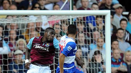West Ham United's Guy Demel (left) and Reading's Nick Blackman jump for a high ball during the Barcl