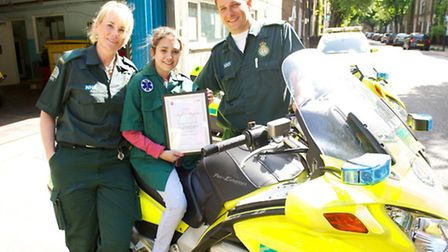 Charlotte Dighton with cystic fibrosis spent a day with the Romford Ambulance Service. Pictured with
