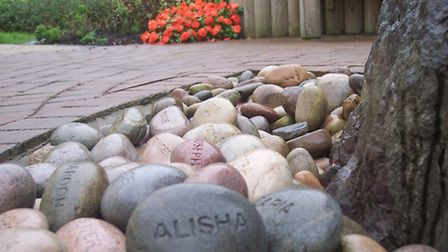 Pebbles in the Memorial Garden feature the names of children and several adults who have died