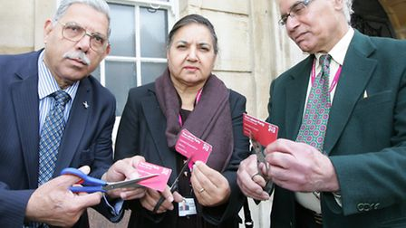 Cllrs Filly Maravala, left, Balvinder Saund and Virendra Tewari cut up their Labour membership cards