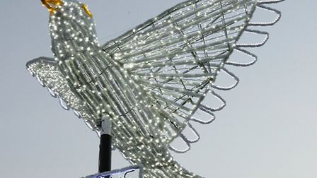 Festive lights on in Seven Kings a giant peace dove and lights with symbols representing the world r