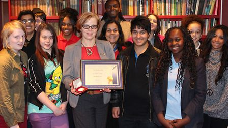 Jan Sharkey-Dodds receiving her Jack Petchy Leadership Award with some of the young people who have