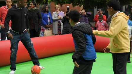 Defoe playes football with local kids before cooking as part of Jamie Oliver's Ministry of Food Stra