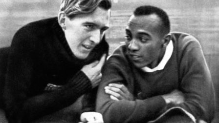 Luz Long of Germany (left) talks to Jesse Owens, USA (right)