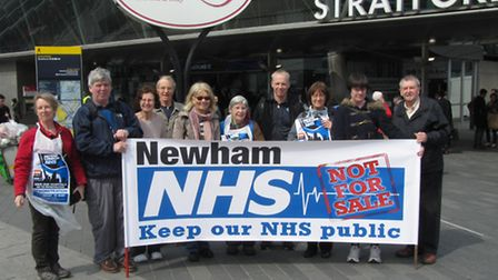 Save Our NHS Newham campaigners outside Stratford Station on the way to the march.