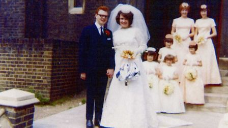 The happy couple are pictured on their wedding day in 1965 with their bridesmaids