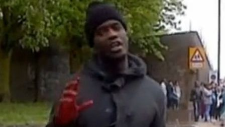 Michael Adebolajo minutes after the killing of soldier Lee Rigby in Woolwich. Credit ITV News.