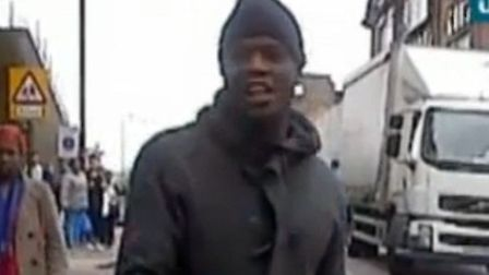 Stills from video footage of Michael Adebolajo after the killing of a soldier in Woolwich. Credit: I