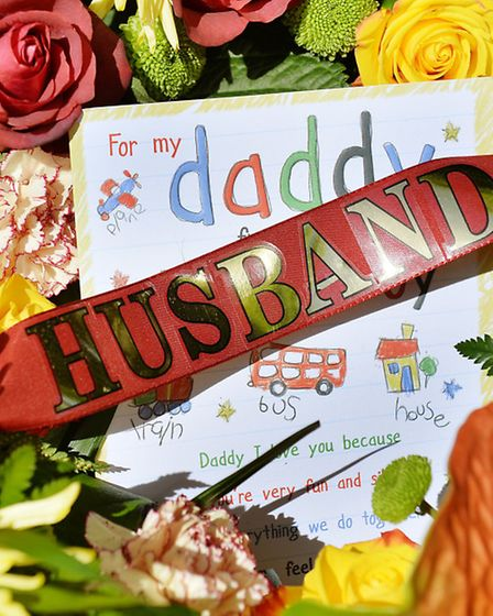 Flowers and a card tied to a wreath believed to have been left by the family of soldier Drummer Lee