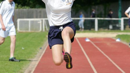 A student from The Albany School taking part in the long jump competition at the Hornchurch Sports S