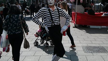A mime artist performs for shoppers as part of Half Term Alfresco Shopping Week.
