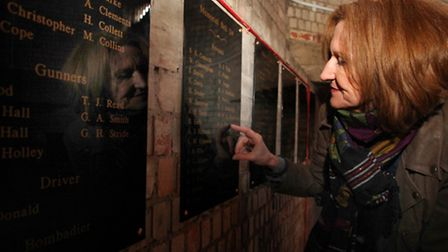 Philippa King reads some of the 197 fallen soldiers' names on the Memorial Bell plaque's inscription