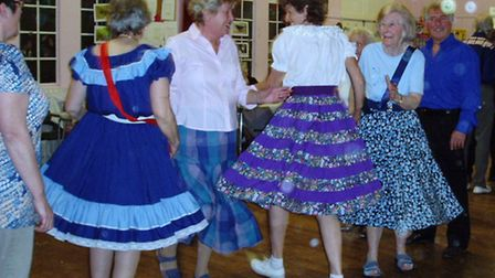 Members of the Lister Square Dance Club celebrate their 61st anniversary.